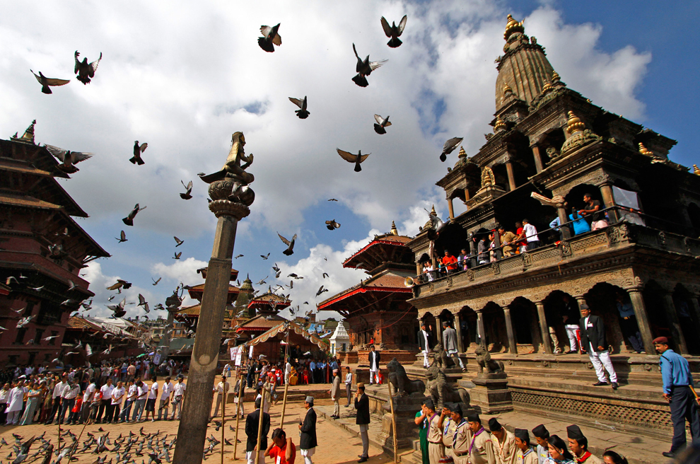 Nepal Pigeons fly as Hindu devotees stand in a line in front of Hindu god Krishna Temple during Janmashtami festival in Katmandu, Nepal, August 21. Niranjan ShresthaAssociated Press