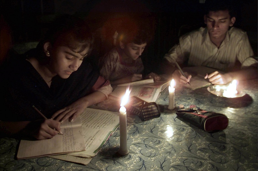 PAKISTANI STUDENTS STUDY BY CANDLELIGHT DUE TO POWER FAILURE IN KARACHI.