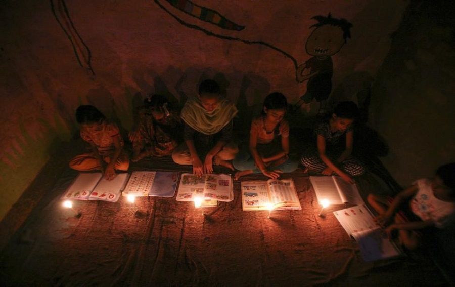 Schoolgirls study by candlelight at a religious school in Noida, New Delhi, during a widespread blackout which cut power to over 300 million residents in northern India. Parivartan SharmaReugters
