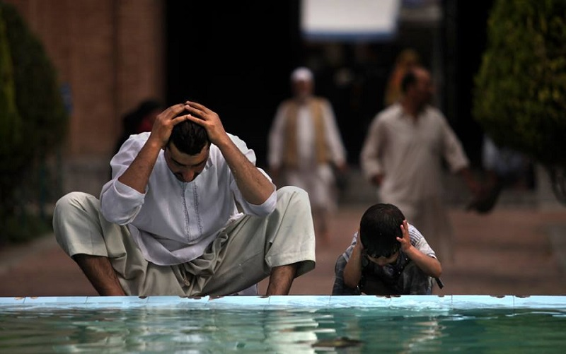 Muslim wash themselves at a fountain in the compound of Jamia Masjid or